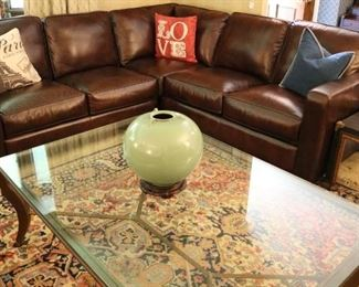 Three piece like new Leather Sectional, Modern Bronze & Glass Coffee Table, Korean Green Pottery