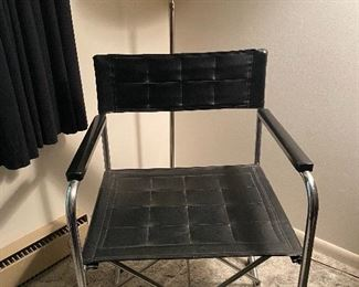 RETRO HALF MOON POLE LAMP AND QUILTED BLACK CHAIR WITH CHROME ARMS AND LEGS