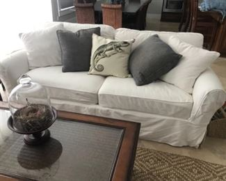 High end duck cloth sofas with slip covers.  Clean and good condition