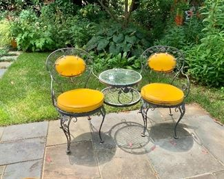 Vintage wrought iron tete-a-tete detail.   Table can accommodate a patio umbrella.