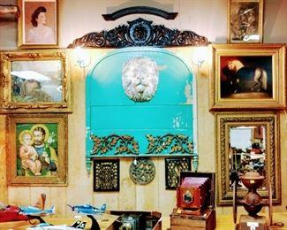 Concrete Lions head, Antique oil on canvas. Coffee grinder,  Model planes,  Magic lantern, Antique camera.