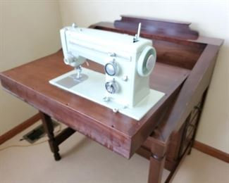 This sewing machine is in a very unusual cabinet