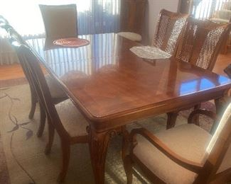 Table and eight chairs with a leaf and pads  Thomasville Napoleon pecan finish