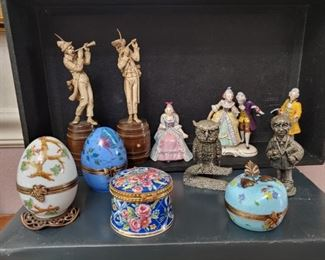 Hand carved statues, limoge trinket boxes, pewter and porcelain figures.