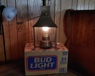 Vintage light can hang or sit on table