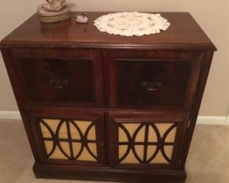 Vintage record/radio cabinet with components removed.