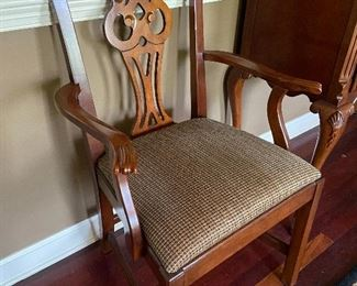 pair of these arm chairs to be used at dining table or extra seating.