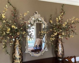 Pair of these floral filled vases. Large scroll-framed mirror.
