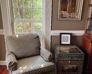 Cushy club chair, decorative chest/table.