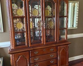 Traditional china hutch ready to display your set.