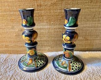 "$50 Pair ceramic candlesticks.  Each 8"" H, base 4.5"" diam."