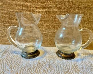 """$45 ea Pair pitchers on silver base 7.5"""" H, 6"""" W, 3.25"""" D"""