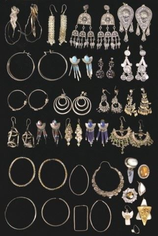 1Grouping of Silver EarringsMostly sterling, some unmarked. 17 complete pairs, including signed, hoops, ear clips, lapis, onyx, Mexican; and 38 single earrings. 406.3 grams total, not including earrings with stones.