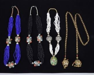 """2Grouping of Beaded Necklaces4 beaded necklaces. 3 with beads and silver tone decoration, 1 with gold tone and jeweled decoration. Black and blue beaded each 24 1/2""""L"""