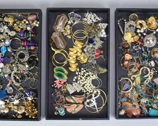4Grouping of Earrings & Ear ClipsLarge grouping of earrings and ear clips. Mostly single, with approximately 20 pairs. Including gold tone, silver tone, beaded, rhinestone, costume, some designer. Some missing posts or clips.