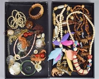 6Grouping of Natural JewelryGrouping of jewelry including shell pendants, carved jade pendant, strand of pearls, wooden bangle, wood carved bead and animal necklaces.