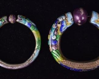 "92 Chinese Sterling & Enamel Dragon Bracelets2 enamel decorated sterling bangles, with dragon motif. Larger 4""-diameter. Some losses to enamel. Silver unmarked. 119.3 grams total, including enamel."