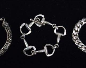 """123 Sterling BraceletsChain bracelet, marked on the clasp Mexico 925; link bracelet with toggle closure, marked 925; woven style BA Suarti toggle bracelet, signed BA and marked 925. Each 9 1/2""""L. 290 grams total"""