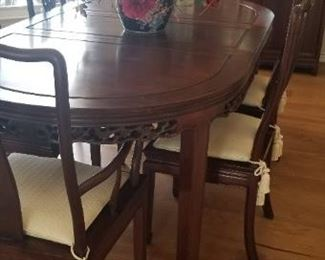 Beautiful carved dining room table and chairs