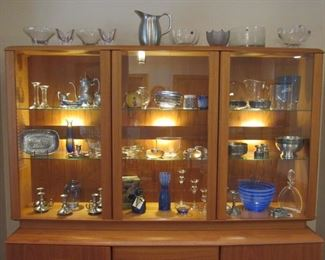 Gorgeous lighted Danish modern teak china cabinet from Nordic Furniture.  Lots of art glass - Orrefors, Konge-Tinn pewter and more...