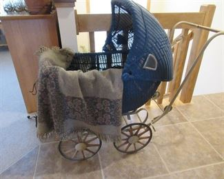 Antique buggy that converts to a stroller.  Vintage wool blanket
