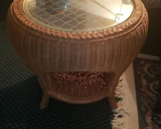 Nice round rattan table with a glass top
