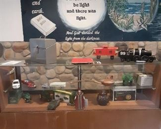 glass display case with lots of John Deere items
