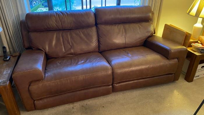 Leather powered motion sofa