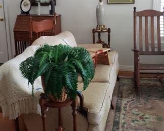greenery, lamp, rocker, creamy white sofa, rug