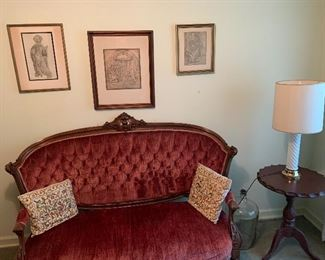 Victorian style settee with velvet cloth seating.