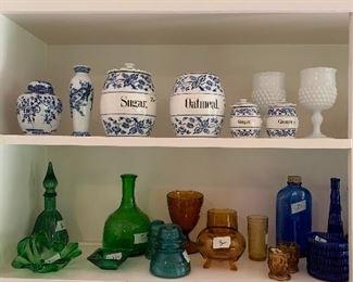 Assortment of colored glassware.