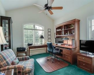 Barcalounger, curio, desk, wooden floor protector, TV and two drawer file cabinet.