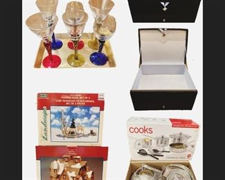 1 Gold Tone Serving Tray•6 wine glasses•1 black velvet compartment•2 Boxes of Christmas Decoration•1 Box of 12 piece Stainless Steel Cookware set