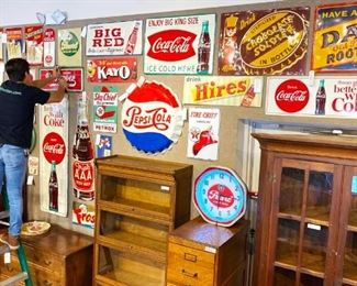 Huge collection of vintage enameled metal advertising signs (Coca-Cola, Pepsi, Pearl Beer, Grapette soda, Dr. Pepper, Big Red, Hippo Cola)