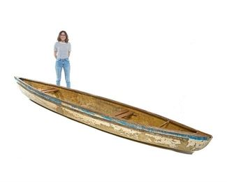 """15' Long Vintage Lake Canoe Large vintage lake canoe, fiberglass and wooden frame, with two seats, blue and white paint remnants 13.5""""h x 185""""w x 30""""d"""