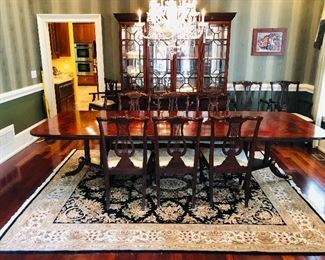 Henkel Harris flame mahogany conference dining room table with 8 Chippendale style chairs and Henkel Harris breakfront.