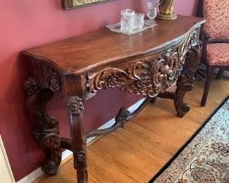 Intricate hand carved imported wood table