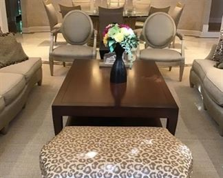 The living room is filled with custom tables and Donghia Ogee sofas, Donghia Armchairs by John Hutton, a fabulous Donghia bench with cheetah fabric and a Paris cocktail table by Donghia
