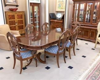 """Antique Formal Dining Set comes with 6 chairs and table pads!  The chairs have been recently re-upholstered with a beautiful navy and white fabric.  There is also a roll of fabric that is included - in  case you ever need to recover or want to use for something else.  With two leaves, this table measures approximately 102"""" x 44""""."""