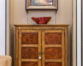 In each section of this cabinet you will see wildlife - very unique and nice!