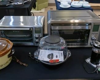 Small kitchen appliances including a convection oven on the right - air fryer on the left.  Orville Red popcorn popper and Mr. Coffee grinder on the right.