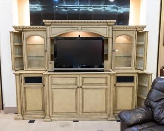 """This 110""""  Home Center is amazing! Using a remote control, the TV can stay hidden until you are ready to watch.  This TV is included with the home center."""