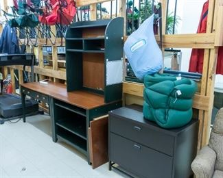 Desk, chests, etc.  Camping too - sleeping bag on right!