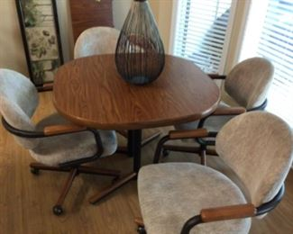 Dining Table with 4 Rolling Chairs and 1 Leaf (Leaf Not Shown)