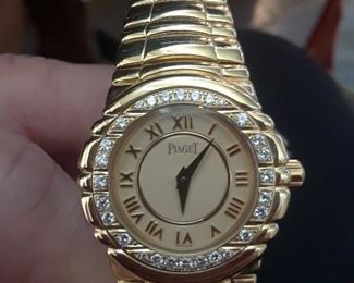 18k gold and diamond Piaget watch in excellent working condition. Box and papers. Raised 18k gold Roman numerals.
