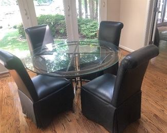 Glass top table with real leather chairs