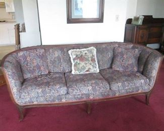 Vintage Ornate Upholstered Sofa with Decorative Throw Pillows