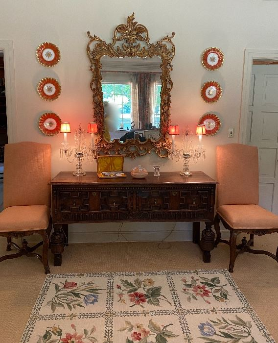 Beautiful English oak Jacobean carved sideboard, carved gold leaf mirror, pair of crystal candelabra lamps, 6 French plates, pair of armless upholstered chairs