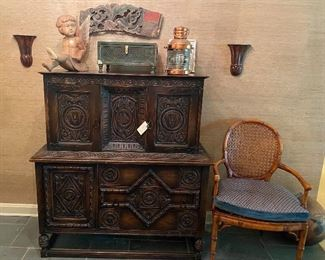 Carved Jacobean chest/bar cabinet, Tudor finish,  by Grand Rapids Bookcase & Chair Co., copper      Masthead  ships lantern, early Asian temple carving,  carved wooden angel