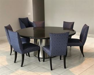 Lot #1  - $1,200 - Table only. 6' diameter black granite top table on a heavy metal base. Chairs sold separately.